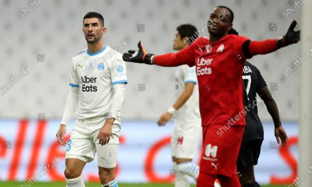 Marseille's Alvaro, left, and goalkeeper Steve Mandanda react during the French League One soccer match between Marseille and Lille at the Stade Velodrome in Marseille, France