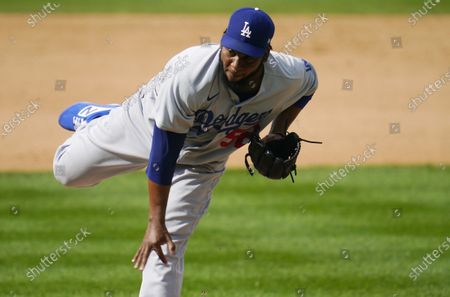 Los Angeles Dodgers relief pitcher Pedro Baez works against the Colorado Rockies in the seventh inning of a baseball game, in Denver