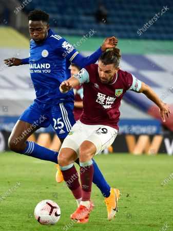 Burnley's Jay Rodriguez (R) in action against Leicester's Wilfred Ndidi (L) during the English Premier League soccer match between Leicester City and Burnley in Leicester, Britain, 20 September 2020.