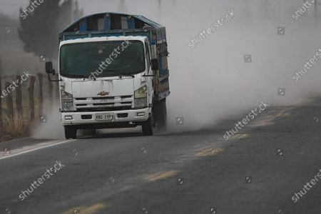 Vehicles travel on a road covered with ash expelled by the Sangay volcano, in the Palmira sector, in the province of Chimborazo, Ecuador, 20 September 2020. An intense fall of volcanic ash was recorded on 20 September 2020 in five towns in the Ecuadorian province of Chimborazo, located in the Andean area of the country, reported the National Service for Risk and Emergency Management (SNGRE). The ash comes from the Sangay volcano which, since 04:20 local time (09:20 GMT) has been registering earthquakes 'that show the occurrence of explosions and ash emissions much more energetic than in previous months'.