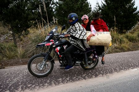 Indigenous people travel on a motorcycle on a road covered by the ash expelled by the Sangay volcano, in the Palmira sector, in the province of Chimborazo, Ecuador, 20 September 2020. An intense fall of volcanic ash was recorded on 20 September 2020 in five towns in the Ecuadorian province of Chimborazo, located in the Andean area of the country, reported the National Service for Risk and Emergency Management (SNGRE). The ash comes from the Sangay volcano which, since 04:20 local time (09:20 GMT) has been registering earthquakes 'that show the occurrence of explosions and ash emissions much more energetic than in previous months'.