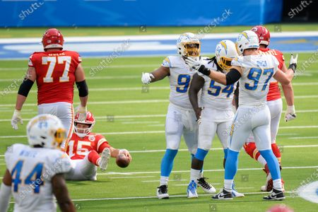 Los Angeles Chargers defensive end Joey Bosa (97), right, celebrates his sack with defensive end Melvin Ingram (54) and defensive tackle Jerry Tillery (99) as Kansas City Chiefs quarterback Patrick Mahomes (15) gets up from the ground during an NFL football game, in Inglewood, Calif