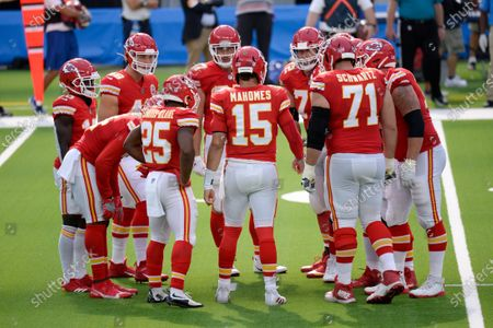 Kansas City Chiefs offense huddles on the field during an NFL football game against the Los Angeles Chargers, in Inglewood, Calif