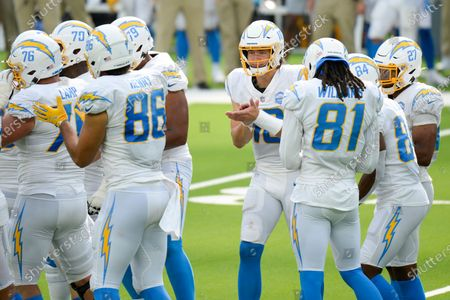 Los Angeles Chargers quarterback Justin Herbert (10) huddles with offense during an NFL football game against the Kansas City Chiefs, in Inglewood, Calif
