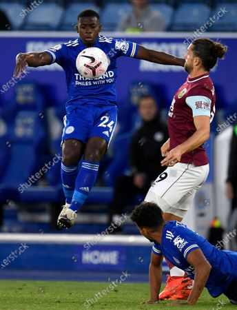 Leicester's Nampalys Mendy (L) in action against Burnley's Jay Rodriguez (R) during the English Premier League soccer match between Leicester City and Burnley in Leicester, Britain, 20 September 2020.