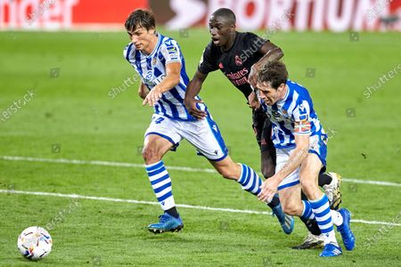 Ferland Mendy of Real Madrid C.F and Robin Le Normand of Real Sociedad and Aritz Elustondo of Real Sociedad