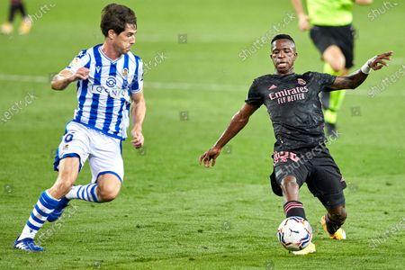 Vinicius Junior of Real Madrid C.F and Aritz Elustondo of Real Sociedad