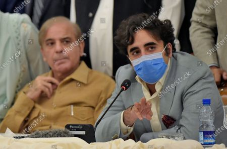 Pakistani opposition parties leaders Bilawal Bhutto Zardari, right, speaks while Shahbaz Sharif looks at a press briefing following their All Parties Conference, in Islamabad, Pakistan, Sunday, Sept. 20. 2020. Pakistani opposition parties demanded immediate resignation of Prime Minister Imran Khan and they launched an alliance to hold a countrywide protest movement against the government