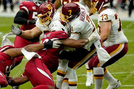 Washington Football Team quarterback Dwayne Haskins (7) is sacked by Arizona Cardinals outside linebacker Devon Kennard during the first half of an NFL football game, in Glendale, Ariz