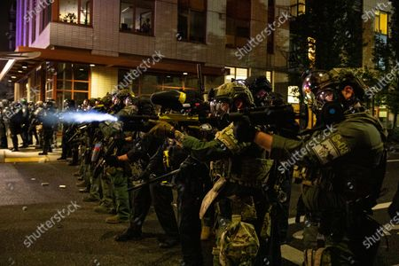 Federal police try to take control of the streets during protests in Portland, Ore. The protests, which began over the killing of George Floyd, often result frequent clashes between protesters and law enforcement. Vandalism but no arrests occurred during a demonstration in downtown Portland involving about 200 people Saturday, Sept. 19, 2020. Frequently violent protests have racked the city for more than three months since the police killing of George Floyd in Minneapolis. Protesters want city officials to slash the police budget and reallocate money to Black residents and businesses. Some demonstrators also demand the resignation of the city's mayor
