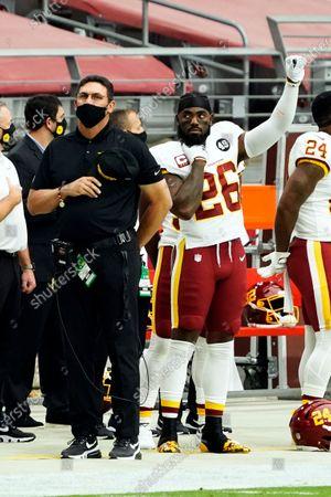 Washington Football Team head coach Ron Rivera and Landon Collins (26) before an NFL football game against the Arizona Cardinals, in Glendale, Ariz