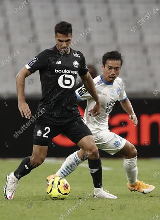 Stock Image of Olympique Marseille's Yuto Nagatomo (R) and Lille OSC's Zeki Celik  (L) in action during the Ligue 1 soccer match between Olympique Marseille and Lille OSC at Orange Velodrome stadium, Marseille, France 20 September 2020.
