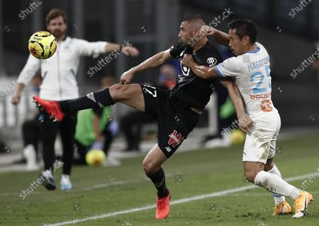 Stock Picture of Olympique Marseille's Yuto Nagatomo (R) and Lille OSC's Burak Yilmaz (L) in action during the Ligue 1 soccer match between Olympique Marseille and Lille OSC at Orange Velodrome stadium, Marseille, France 20 September 2020.