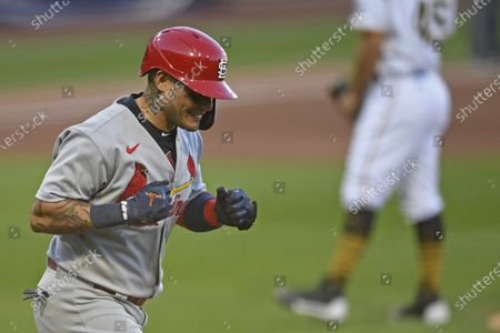 St. Louis Cardinals' Yadier Molina reacts while running the bases after hitting a two-run home run off Pittsburgh Pirates relief pitcher Derek Holland during the seventh inning of a baseball game, in Pittsburgh
