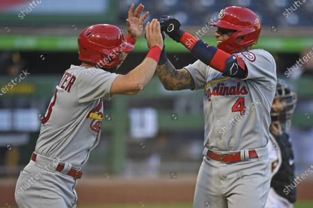 Stock Photo of St. Louis Cardinals' Yadier Molina, right, celebrates with Matt Carpenter after hitting a two-run home run off Pittsburgh Pirates relief pitcher Derek Holland during the seventh inning of a baseball game, in Pittsburgh