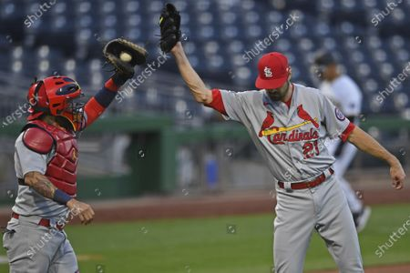 St. Louis Cardinals relief pitcher Andrew Miller, right, is congratulated by catcher Yadier Molina after they defeated the Pittsburgh Pirates in a baseball game, in Pittsburgh
