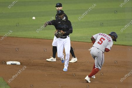 Miami Marlins shortstop Jazz Chisholm throws to first base for a double play after tagging out Josh Harrison during the first inning of a second game of doubleheader against the Washington Nationals, in Miami