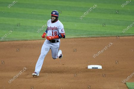 Washington Nationals Victor Robles rounds second base after hitting a two-run home run in the sixth inning during the second baseball game of a doubleheader against the Miami Marlins, in Miami