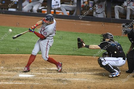 Washington Nationals' Asdrubal Cabrera hits a single to right field in the sixth inning during the second baseball game of a doubleheader against the Miami Marlins, in Miami
