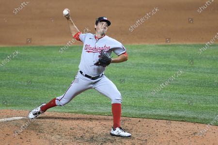 Washington Nationals' Ryne Harper delivers a pitch during the seventh inning of the second game of a doubleheader against the Miami Marlins