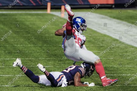 New York Giants running back Saquon Barkley (Top) is upended by Chicago Bears cornerback Kyle Fuller (Bottom) during the NFL game between the New York Giants and the Chicago Bears at Soldier Field in Chicago, Illinois, USA, 20 September 2020.