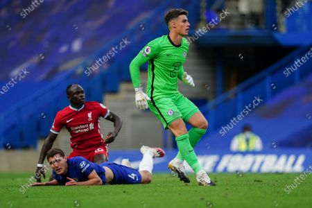 Kepa Arrizabalaga of Chelsea clears the ball after Andreas Christensen of Chelsea tackles Sadio Mane of Liverpool to the ground