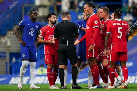 Virgil van Dijk of Liverpool reacts to the referee as Andreas Christensen of Chelsea receives a red card for tackling Sadio Mane of Liverpool to the ground
