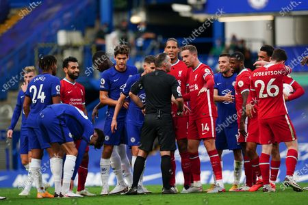 Liverpool captain Jordan Henderson reacts to the referee as Andreas Christensen of Chelsea receives a red card for tackling Sadio Mane of Liverpool to the ground