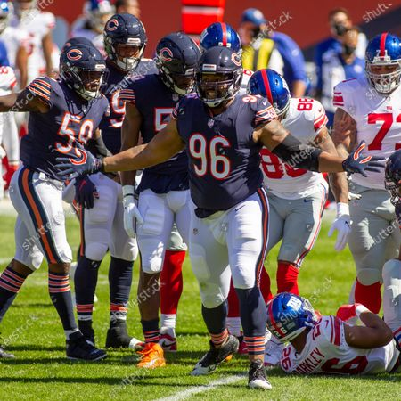 Stock Photo of Chicago, Illinois, U.S. - Bears #96 Akiem Hicks celebrates his tackle of Giants #26 Saquon Barkley during the NFL Game between the New York Giants and Chicago Bears at Soldier Field in Chicago, IL. Photographer: Mike Wulf