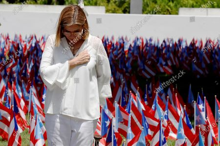 Stock Photo of Mayor of San Juan Carmen Yulin Cruz pays tribute next to 3,000 national flags that commemorate the dead after Hurricane Maria, in San Juan, Costa Rica, 20 September 2020. An ecumenical ceremony held in the Luis Munoz Marin Park in San Juan this Sunday, recalled the passage of Hurricane Maria three years ago on the island, one of the most devastating hurricanes to hit the Caribbean territory.