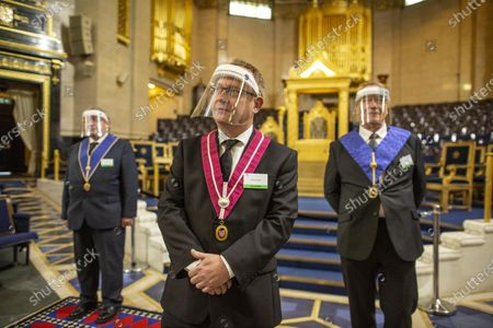 Freemasons  (left) Martin Bullard, (centre) James Jarvis and (right) Ian Clark stood together in front of the throne inside the Grand Temple at the lodge in Covent Garden