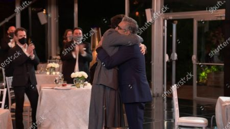 "Dan Levy, left, and Eugene Levy, winner of Outstanding Lead Actor in a Comedy Series for ""Schitt's Creek"" hug during the 72nd Emmy Awards telecast on at 8:00 PM EDT/5:00 PM PDT on ABC"