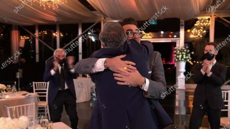 "Stock Image of Daniel Levy, winner of the Emmy for Outstanding Writing for a Comedy Series for ""Schitt's Creek"" hugs Eugene Levy during the 72nd Emmy Awards telecast on at 8:00 PM EDT/5:00 PM PDT on ABC"