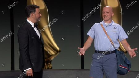 Jimmy Kimmel, left, and Anthony Carrigan speak on stage during the 72nd Emmy Awards telecast on at 8:00 PM EDT/5:00 PM PDT on ABC