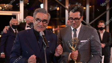 "Stock Picture of Eugene Levy, left, and Daniel Levy from ""Schitt's Creek"" accept the Emmy for Outstanding Comedy Series during the 72nd Emmy Awards telecast on at 8:00 PM EDT/5:00 PM PDT on ABC"