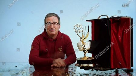 """John Oliver from """"Last Week Tonight with John Oliver"""" accepts the Emmy for Outstanding Variety Talk Series during the 72nd Emmy Awards telecast on at 8:00 PM EDT/5:00 PM PDT on ABC"""