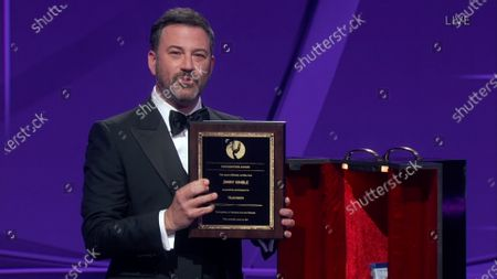 Jimmy Kimmel receives a participation award during the 72nd Emmy Awards telecast on at 8:00 PM EDT/5:00 PM PDT on ABC