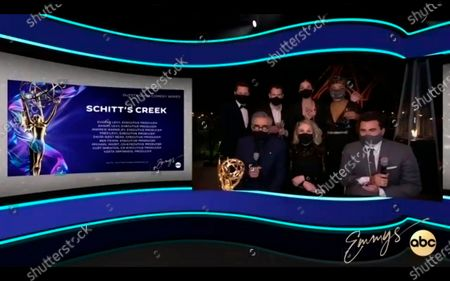 "This video grab captured during the 72nd Emmy Awards Media Center, shows Noah Reid, from top left, Andrew Cividino, Annie Murphy, Karen Robinson, and from bottom left, Eugene Levy, Catherine O'Hara, and Daniel Levy of ""Schitt's Creek"" being interviewed about their Emmy wins during the 72nd Emmys on Sunday, Sept 20. 2020"