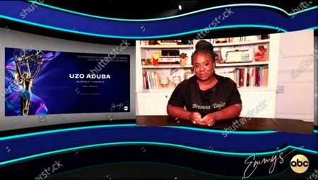 "This video grab captured during the 72nd Emmy Awards Media Center, shows Uzo Aduba being interviewed about her win for Outstanding Supporting Actress in a Limited Series or Movie for ""Mrs. America"" during the 72nd Emmys on Sunday, Sept 20. 2020"