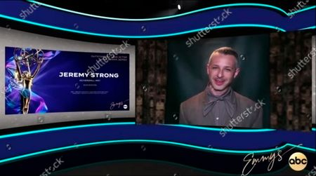 """This video grab captured during the 72nd Emmy Awards Media Center, shows Jeremy Strong being interviewed about his win for Outstanding Lead Actor in a Drama Series for """"Succession"""" during the 72nd Emmys on Sunday, Sept 20. 2020"""