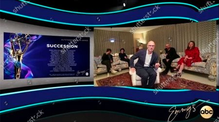 """This video grab captured during the 72nd Emmy Awards Media Center, shows Jesse Armstrong, center, and the team being interviewed about their win for Outstanding Drama Series for """"Succession"""" during the 72nd Emmys on Sunday, Sept 20. 2020"""