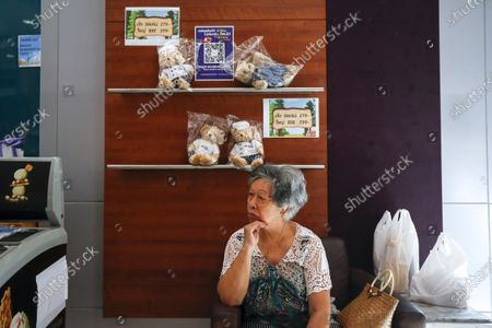 A customer waits for her order inside the new Thai Catering cafeteria at the Thai Airways office building in downtown Bangkok, Thailand, 21 September 2020. Thai Airways turned the company's downtown ticketing office into a cafeteria operated by Thai Catering. The cafeteria sells inflight-style meals and pastries, while customers queue up in long lines during morning hours to buy 'pa tong go', traditional dough fritters, mostly eaten for breakfast. Thai Catering staff as well as staff formerly employed in ticketing sales and customer service, now work at the cafeteria, helping keep the staff employed at a time when the company is experiencing major financial losses due to travel restrictions caused by the COVID-19 pandemic. On 14 September 2020, Thailand's Central Bankruptcy Court approved the airline's debt restructuring plan as the company was set to file for bankruptcy.