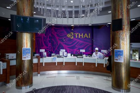 A Thai Airways chef waits for customers at the new Thai Catering cafeteria at the Thai Airways office building in downtown Bangkok, Thailand, 21 September 2020. Thai Airways turned the company's downtown ticketing office into a cafeteria operated by Thai Catering. The cafeteria sells inflight-style meals and pastries, while customers queue up in long lines during morning hours to buy 'pa tong go', traditional dough fritters, mostly eaten for breakfast. Thai Catering staff as well as staff formerly employed in ticketing sales and customer service, now work at the cafeteria, helping keep the staff employed at a time when the company is experiencing major financial losses due to travel restrictions caused by the COVID-19 pandemic. On 14 September 2020, Thailand's Central Bankruptcy Court approved the airline's debt restructuring plan as the company was set to file for bankruptcy.