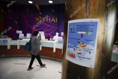 A sign advises customers how to order inflight-style food at the new Thai Catering cafeteria at the Thai Airways office building in downtown Bangkok, Thailand, 21 September 2020. Thai Airways turned the company's downtown ticketing office into a cafeteria operated by Thai Catering. The cafeteria sells inflight-style meals and pastries, while customers queue up in long lines during morning hours to buy 'pa tong go', traditional dough fritters, mostly eaten for breakfast. Thai Catering staff as well as staff formerly employed in ticketing sales and customer service, now work at the cafeteria, helping keep the staff employed at a time when the company is experiencing major financial losses due to travel restrictions caused by the COVID-19 pandemic. On 14 September 2020, Thailand's Central Bankruptcy Court approved the airline's debt restructuring plan as the company was set to file for bankruptcy.