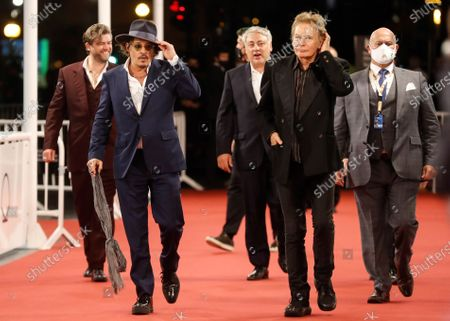 Johnny Depp (2-L) and British filmmaker Julien Temple (2-R) arrive to the premiere of the film 'Crock of Gold: A few rounds with Shane MacGowan' as part of 68th San Sebastian International Film Festival in the city of San Sebastian, northern Spain, late 20 September 2020 (issued on 21 September 2020). The film competes in the official section of the festival running until 26 September.