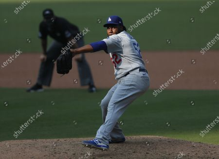 Pedro Baez of the Los Angeles Dodgers pitches in the 9th inning against the San Diego Padres at Petco Park on Wednesday, Sept.16, 2020 in San Diego, CA. (K.C. Alfred / The San Diego Union-Tribune)