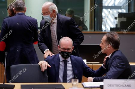 Irish Foreign minister Simon Coveney (L), German Minister of Foreign Affairs Heiko Maas (R) and European High Representative of the Union for Foreign Affairs, Josep Borrell (Up) during a Foreign affairs ministers council in Brussels, Belgium, 21 September 2020.