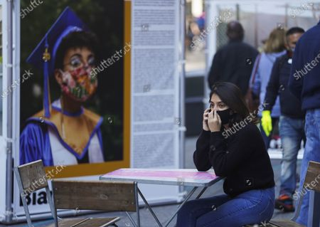 Stock Photo of A woman makes phone call on Times Square in New York, the United States, Sept. 20, 2020. The number of COVID-19 deaths in the United States on Sunday reached 199,474 as of 8:22 p.m. local time (0022 GMT Monday), according to the Center for Systems Science and Engineering (CSSE) at Johns Hopkins University.