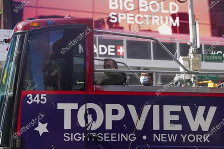 Stock Picture of A sightseeing bus runs on Times Square in New York, the United States, Sept. 20, 2020. The number of COVID-19 deaths in the United States on Sunday reached 199,474 as of 8:22 p.m. local time (0022 GMT Monday), according to the Center for Systems Science and Engineering (CSSE) at Johns Hopkins University.