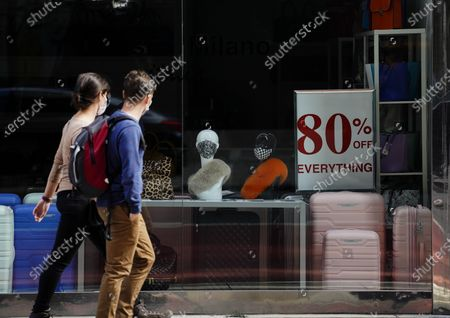 Pedestrians walk past a store in New York, the United States, Sept. 20, 2020. The number of COVID-19 deaths in the United States on Sunday reached 199,474 as of 8:22 p.m. local time (0022 GMT Monday), according to the Center for Systems Science and Engineering (CSSE) at Johns Hopkins University.
